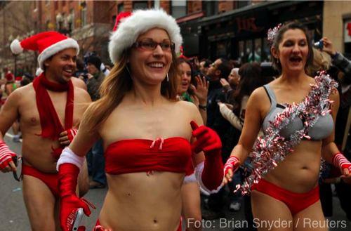 Participants start the annual Santa Speedo Run through the streets of the Back Bay neighborhood of Boston